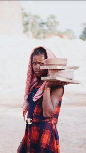Girl Carrying Bricks